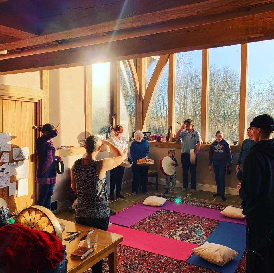 People Drumming in a Beautiful Setting